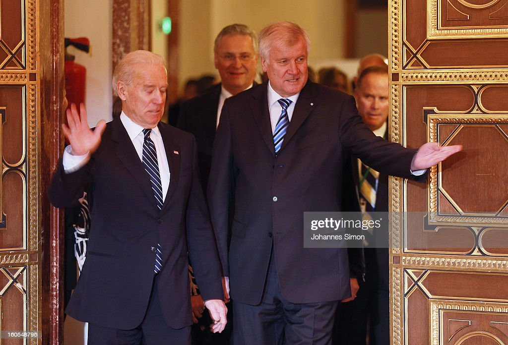 U.S. Vice President Joe Biden, beside of Joachim Herrmann, Bavarian interior minister and Bavarian state Governor <a gi-track='captionPersonalityLinkClicked' href=/galleries/search?phrase=Horst+Seehofer&family=editorial&specificpeople=4273631 ng-click='$event.stopPropagation()'>Horst Seehofer</a> arrives for to sign a golden book during a reception for the participants of the Munich conference on security policy on February 2, 2013 in Munich, Germany. The Munich Security Conference brings together senior figures from around the world to engage in an intensive debate on current and future security challenges and remains the most important independent forum for the exchange of views by international security policy decision-makers.