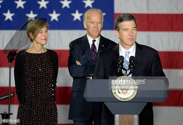 Vice president Joe Biden center listens as he is introduced by current North Carolina Attorney General and Democratic gubernatorial candidate Roy...