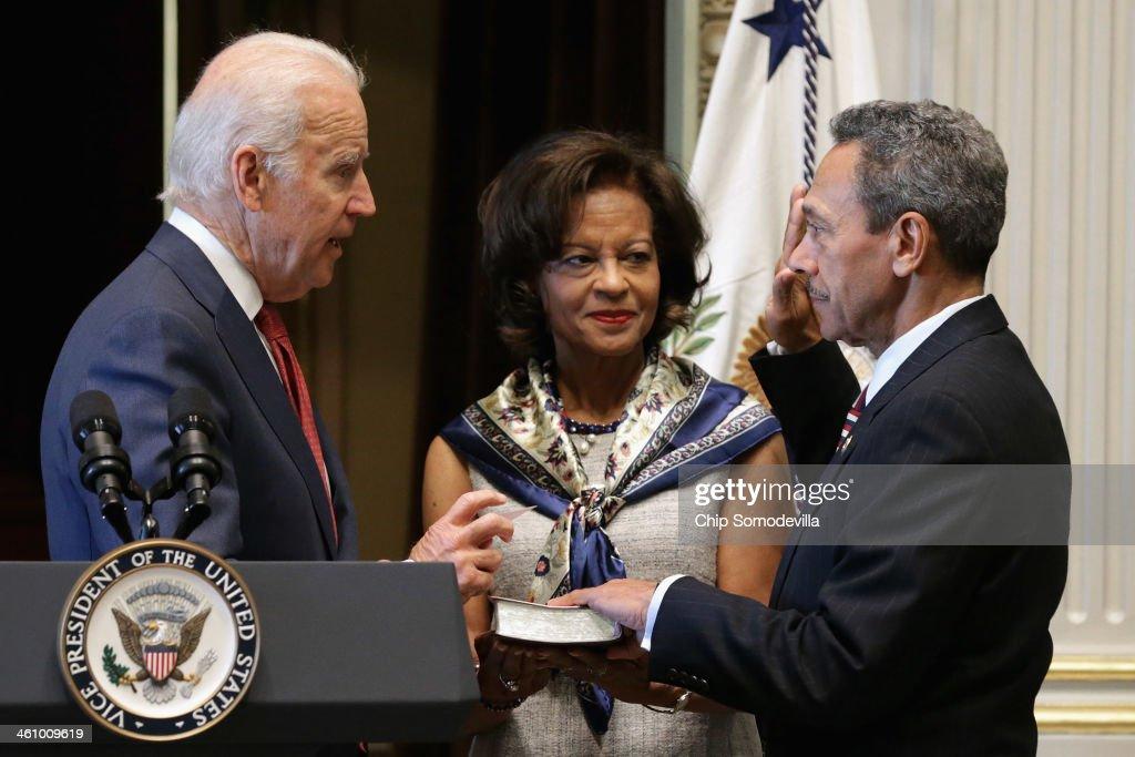 S Vice President Joe Biden ceremonially swears in Mel Watt as the new director of the Federal Housing Finance Agency as his wife Eulada Watt looks on...