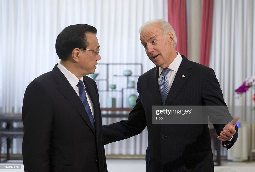 S Vice President Joe Biden chats with Chinese Premier Li Keqiang before heading to their meeting at the Zhongnanhai diplomatic compound on December 5...