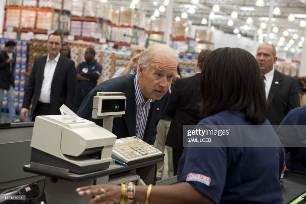 US Vice President Joe Biden checks out his purchases during a visit to a Costco store on a shopping trip in Washington, DC, on November 29, 2012. Biden made the visit to the first Costco store located in Washington, DC, during its grand opening. AFP PHOTO / Saul LOEB