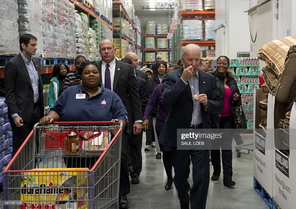 US Vice President Joe Biden eats a food sample during a visit to a Costco store on a shopping trip in Washington, DC, on November 29, 2012. Biden made the visit to the first Costco store located in Washington, DC, during its grand opening. AFP PHOTO / Saul LOEB