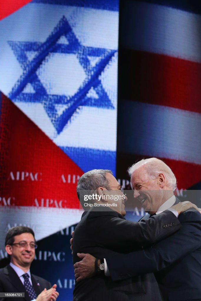 U.S. Vice President Joe Biden (R) embraces Israel Defense Minister <a gi-track='captionPersonalityLinkClicked' href=/galleries/search?phrase=Ehud+Barak&family=editorial&specificpeople=202888 ng-click='$event.stopPropagation()'>Ehud Barak</a> (C) during the American Israel Public Affairs Committee's annual policy conference at the Washington Convention Center March 4, 2013 in Washington, DC. Biden boldly confirmed the political, historical and military ties between the two countries and emphasized President Barack Obama's support for Israel, which he will visit later this month.