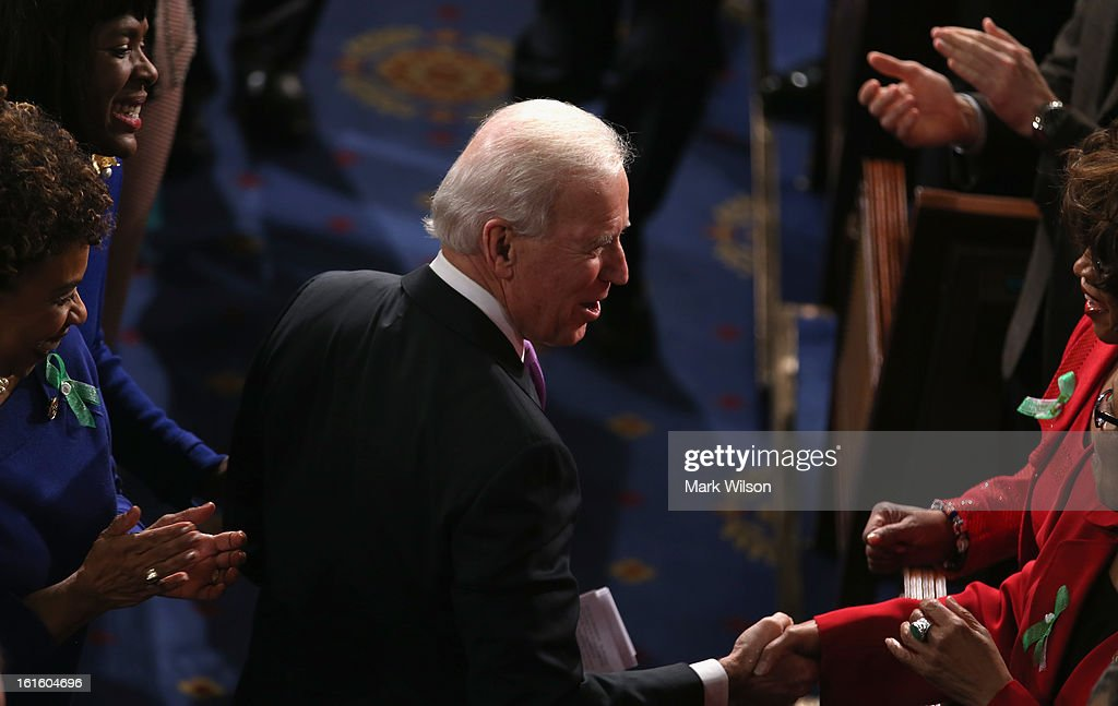 U.S. Vice President Joe Biden enters the House chamber before U.S. President Barack Obama's State of the Union address February 12, 2013 in Washington, DC. Facing a divided Congress, Obama is expected to focus his speech on new initiatives designed to stimulate the U.S. economy.
