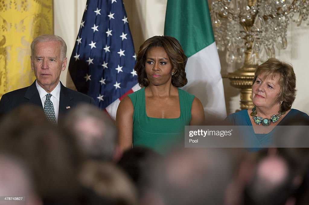 U.S. Vice President Joe Biden, first lady <a gi-track='captionPersonalityLinkClicked' href=/galleries/search?phrase=Michelle+Obama&family=editorial&specificpeople=2528864 ng-click='$event.stopPropagation()'>Michelle Obama</a> and Fionnuala O'Kelly, wife of Prime Minister Kenny attend a St. Patrick's Day reception attended by President Obama and the Irish prime Minister in the East Room of the White House March 14, 2014 in Washington, DC.