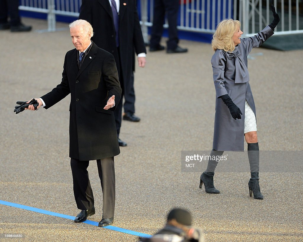 U.S. Vice President Joe Biden gestures toward a spectator, as his wife, Dr. Jill Biden, waves to supporters during the Inauguration Parade for the second term of U.S. President Barack Obama in Washington, D.C., Monday, January 21, 2013.