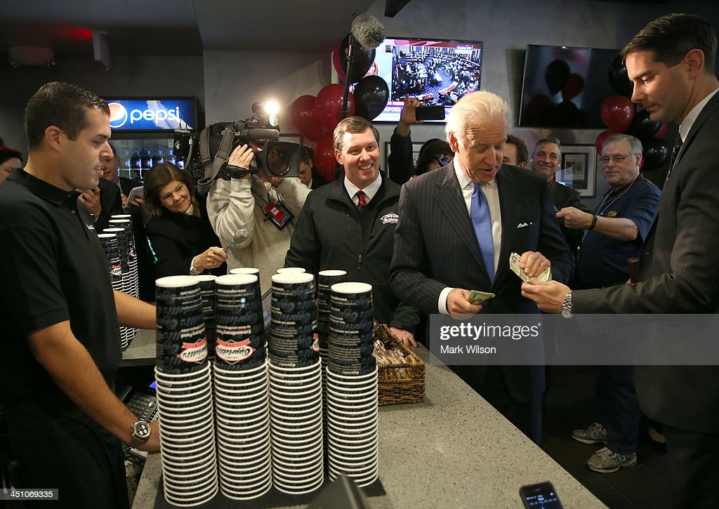 Vice President Joe Biden gets money to pay for his lunch at Capriotti's sandwhich shop, on November 21, 2013 in Washington, DC. Capriotti's is a Delaware based Italian hoagie chain and a favorite of the Vice President.
