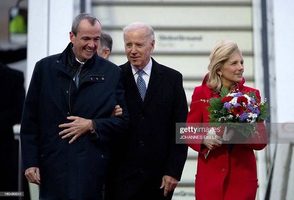 US Vice President Joe Biden (C) gets out of his plane with his wife Jill Biden upon arrival at the Tegel military airport in Berlin on February 1, 2013. Biden is to meet German Chancellor Angela Merkel for talks ahead of the Munich Security Conference. EISELE