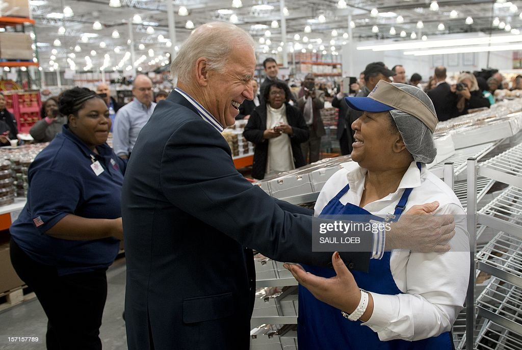 US Vice President Joe Biden greets a store workers as he shops for pies during a visit to a Costco store in Washington, DC, on November 29, 2012. Biden made the visit to the first Costco store located in Washington, DC, during its grand opening. AFP PHOTO / Saul LOEB