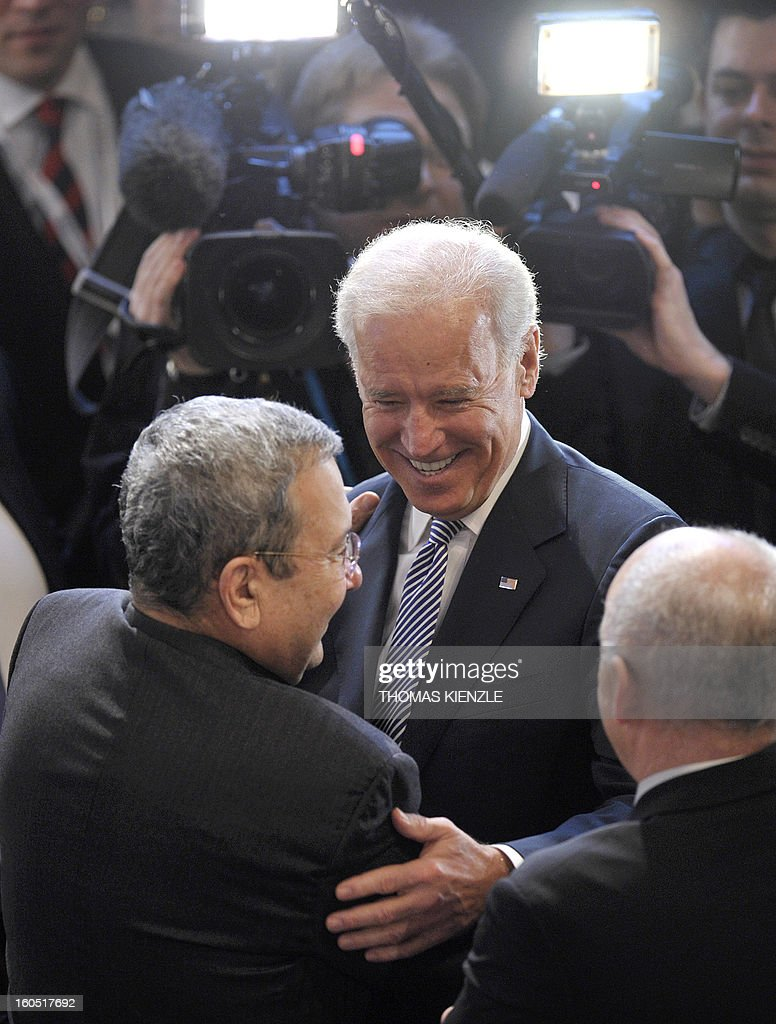 US Vice President Joe Biden (C) greets deputy Prime Minister and Minister of Defence of Israel, Ehud Barak (L), at the Munich Security Conference on February 2, 2013 in Munich, southern Germany as world leaders, ministers and top military gather for talks with the spotlight on Syria, Mali and Iran. AFP PHOTO / THOMAS KIENZLE