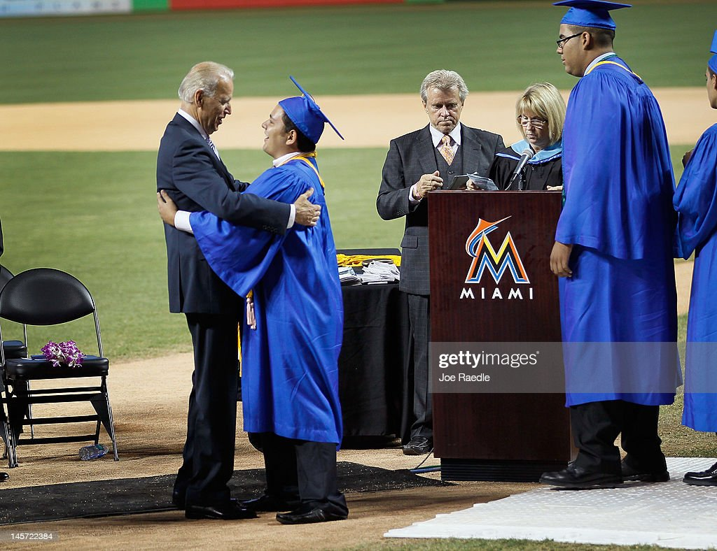 Vice President Joe Biden (L)greets graduates during the commencement ceremony, where he spoke, for Cypress Bay High School graduates at Marlins Park on June 4, 2012 in Miami, Florida. With Florida being an important swing state in the national election both Biden and President Barack Obama along with the Republican challengers are expected to make more campaign appearances before voters head to the polls in November.