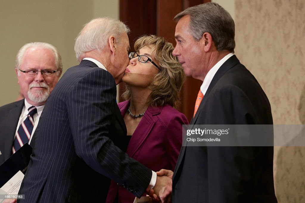 U.S. Vice President Joe Biden greets (L-R) U.S. Rep. Ron Barber (D-AZ), former U.S. Rep. <a gi-track='captionPersonalityLinkClicked' href=/galleries/search?phrase=Gabrielle+Giffords&family=editorial&specificpeople=6961081 ng-click='$event.stopPropagation()'>Gabrielle Giffords</a> (D-AZ) and Speaker of the House <a gi-track='captionPersonalityLinkClicked' href=/galleries/search?phrase=John+Boehner&family=editorial&specificpeople=274752 ng-click='$event.stopPropagation()'>John Boehner</a> (R-OH) during the dedication ceremony of the Gabriel Zimmerman Meeting Room in the U.S. Capitol Visitors Center April 16, 2013 in Washington, DC. A member of Giffords' Congressional staff, Gabriel Zimmerman was murdered during a shooting spree January 8, 2011 that left six dead and 13 injured, including Giffords.