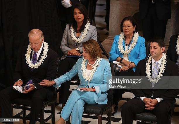 Vice President Joe Biden House Minority Leader Nancy Pelosi House Speaker Paul Ryan RepTulsi Gabbard and Sen Mazie Hirono attend a memorial service...