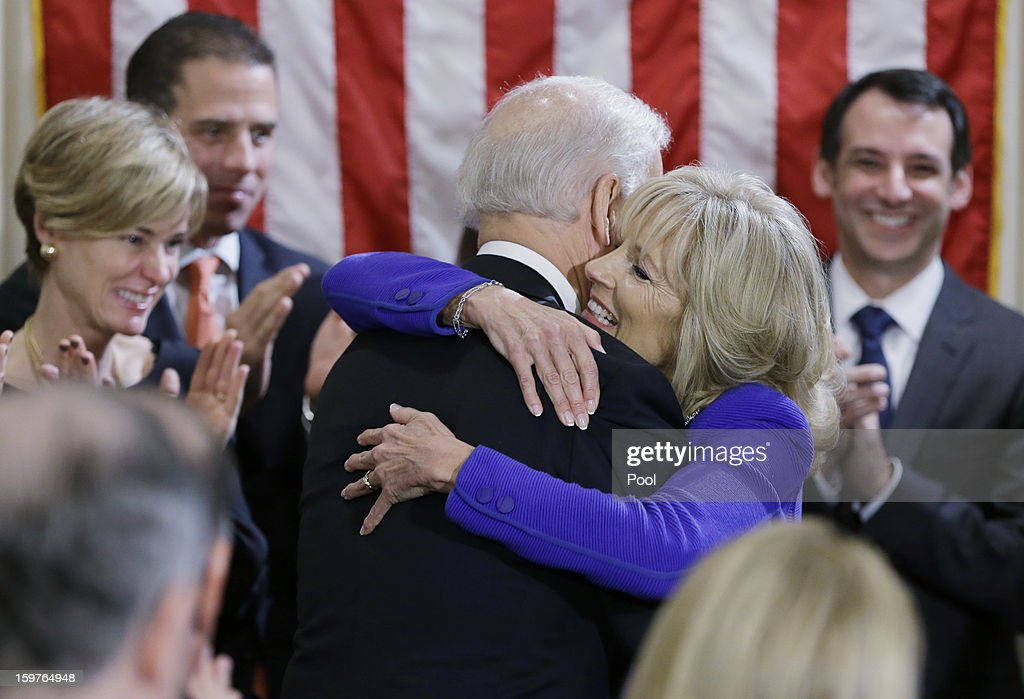 U.S. Vice President Joe Biden (C) hugs his wife Dr. Jill Biden (2dn R) after taking the oath of office on during the official swearing-in ceremony at the Naval Observatory on January 20, 2013 in Washington, DC. Biden and U.S. President Barack Obama will be officially sworn in a day before the ceremonial inaugural swearing-in.