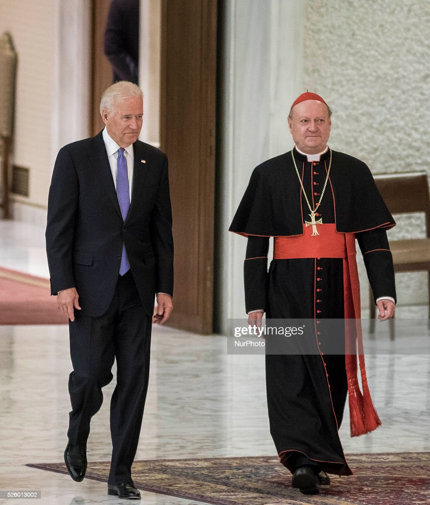 US Vice President Joe Biden (L) is flanked by Cardinal Gianfranco Ravasi (R) as he arrives to attend a special audience celebrates by Pope Francis with participants at a congress on the progress of regenerative medicine and its cultural impact in the Paul VI hall in Vatican City, Vatican on April 29, 2016.