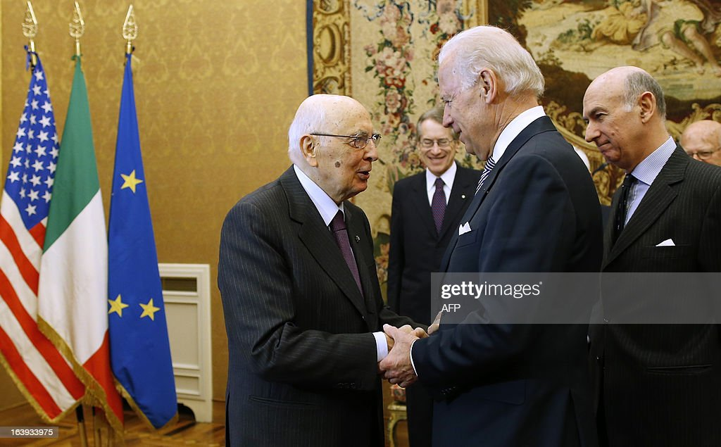 U.S. Vice President Joe Biden is greeted by Italy's President Giorgio Napolitano (L) at the Quirinale palace in Rome on March 18, 2013. Biden is in Italy to attend the inaugural mass of newly-elected Pope Francis, which is to be held at the Vatican on Tuesday. AFP PHOTO POOL / TONY GENTILE