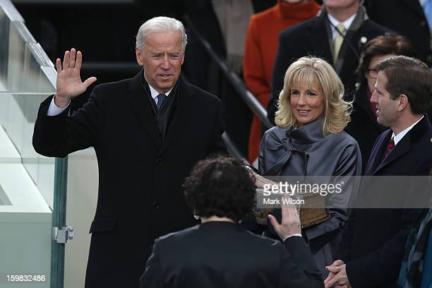 S Vice President Joe Biden is sworn in by Supreme Court Justice Sonia Sotomayor as wife Dr Jill Biden and son Beau Biden look on during the...