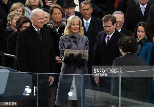 S Vice President Joe Biden is sworn in during the public ceremony by Supreme Court Justice Sonia Sotomayor as Dr Jill Biden and Beau Biden look on...