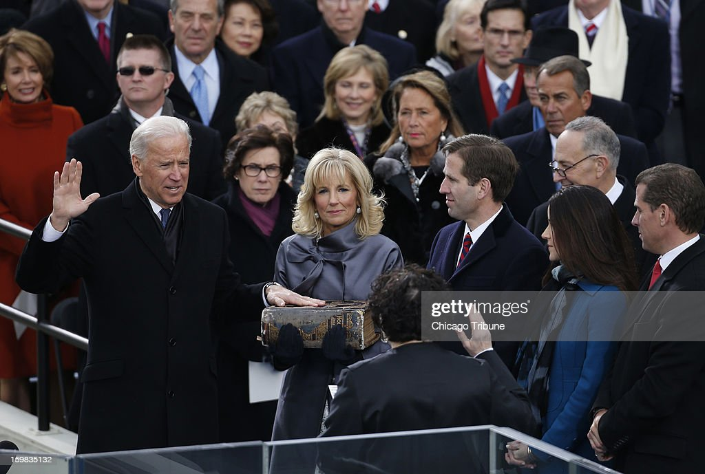 U.S. Vice President Joe Biden (left) is sworn-in by Supeme Court Justice Sonia Sotomayor as his wife Jill (center) holds the bible for him during the 57th presidential inauguration ceremonial swearing-in at the US Capitol on January 21, 2013 in Washington, DC.