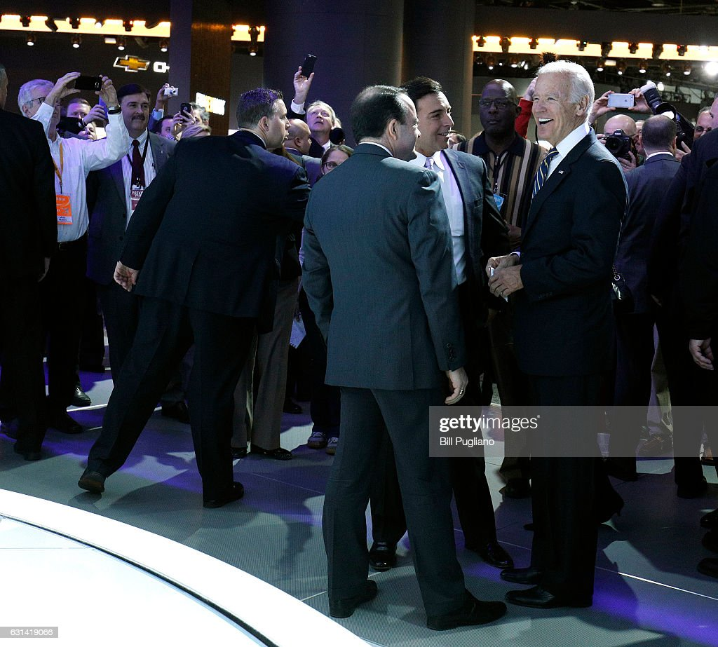 Vice President Joe Biden (right) laughs with Ford CEO Mark Fields (to his left) as he tours the 2017 North American International Auto Show (NAIAS) on January 10, 2017 in Detroit, Michigan. Approximately 5000 journalists from around the world and nearly 800,000 people are expected to attend the NAIAS between January 8th and January 22nd to see the more than 750 vehicles and numerous interactive displays.