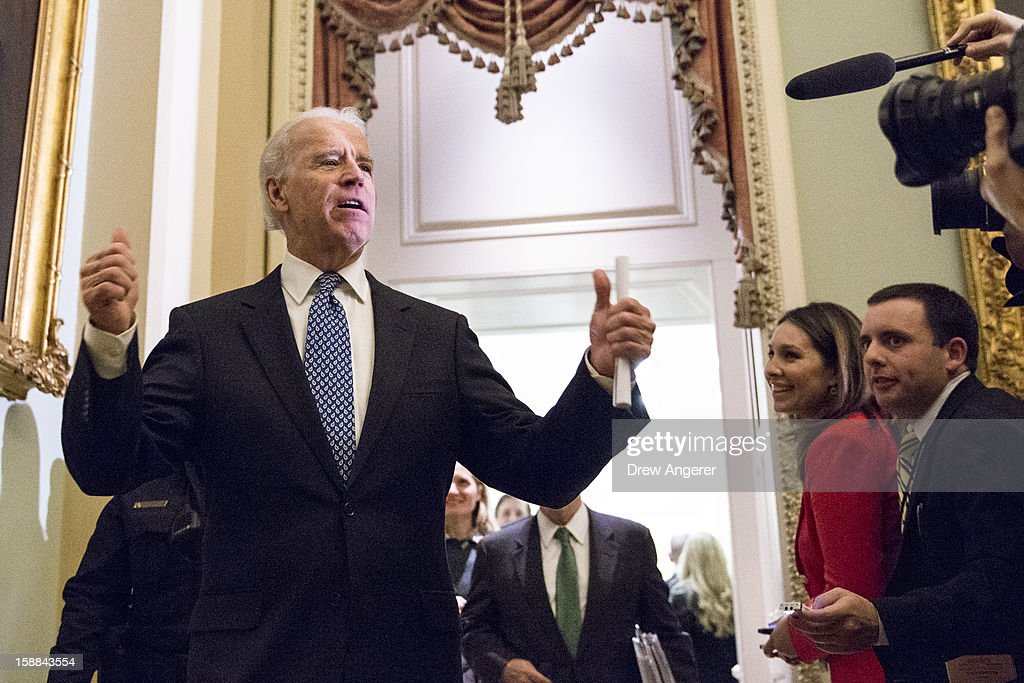 U.S. Vice President Joe Biden leaves a closed-door meeting with Senate Democrats to urge them to support a tentative tax agreement with Republicans on Capitol Hill on December 31, 2012, in Washington DC. The Senate stayed in session on New Year's Eve to try to deal with the looming fiscal cliff issue.