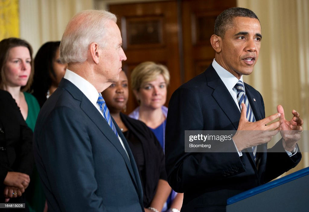 U.S. Vice President Joe Biden, left, looks on as President <a gi-track='captionPersonalityLinkClicked' href=/galleries/search?phrase=Barack+Obama&family=editorial&specificpeople=203260 ng-click='$event.stopPropagation()'>Barack Obama</a> speaks during an event in the East Room of the White House in Washington, D.C., U.S., on Thursday, March 28, 2013. Obama, with families of victims of the Connecticut school shooting tragedy at his side, pressed the Senate to pass gun-control legislation next month and urged lawmakers to resist any weakening of resolve. Photographer: Joshua Roberts/Bloomberg via Getty Images