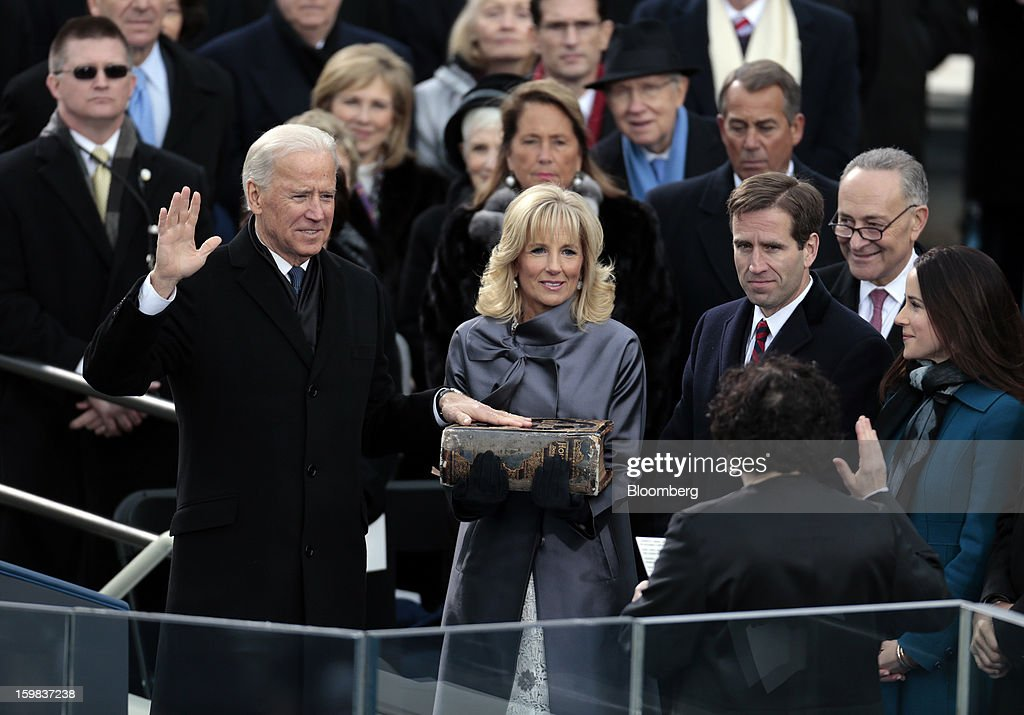 U.S Vice President Joe Biden, left, takes the oath of office from Supreme Court Justice Sonia Sotomayor, right, while his wife Jill Biden, holding the Biden family Bible, looks on during the ceremonial swearing-in at the U.S. presidential inauguration in Washington, D.C., U.S., on Monday, Jan. 21, 2013. As he enters his second term President Barack Obama has shed the aura of a hopeful consensus builder determined to break partisan gridlock and adopted a more confrontational stance with Republicans. Photographer: Andrew Harrer/Bloomberg via Getty Images