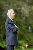 US Vice President Joe Biden listens as the US National Anthem is played during a welcoming ceremony at Government House in Auckland on July 21 2016...