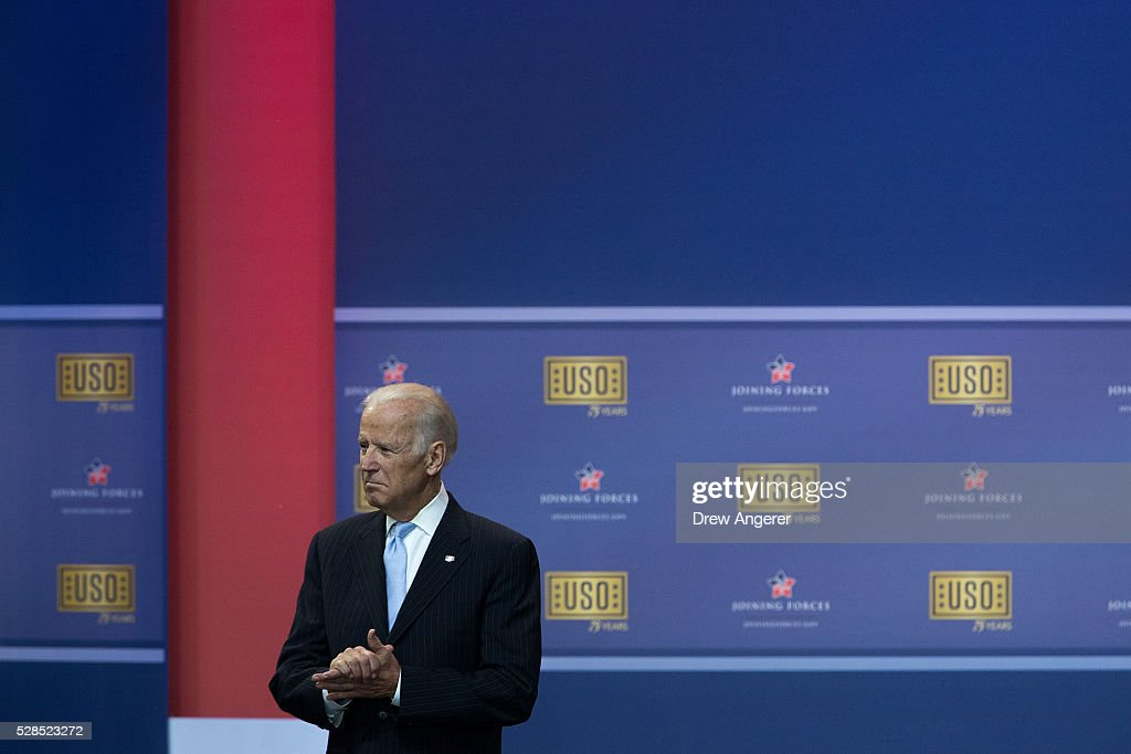 Vice President Joe Biden listens to President Barack Obama speak during a comedy show organized by United Services Organizations (USO) for members of the military and their families, at Andrews Air Force Base, May 5, 2016, in Joint Base Andrews, Maryland. The program is also being live streamed for active duty service members stationed at bases domestically and abroad.