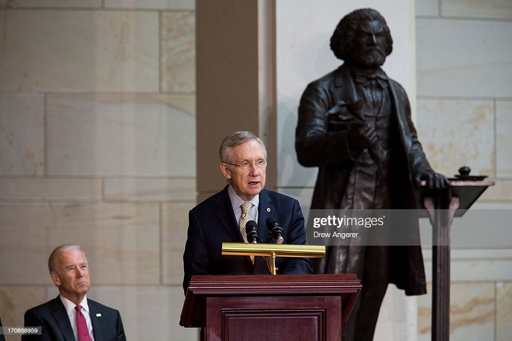 U.S. Vice President Joe Biden looks on, as Senate Majority Leader <a gi-track='captionPersonalityLinkClicked' href=/galleries/search?phrase=Harry+Reid+-+Politician&family=editorial&specificpeople=203136 ng-click='$event.stopPropagation()'>Harry Reid</a> (D-NV) delivers remarks during a dedication ceremony for the new Frederick Douglass Statue in Emancipation Hall in the Capitol Visitor Center, at the U.S. Capitol, on June 19, 2013 in Washington, DC. The 7 foot bronze statue of Douglass joins fellow black Americans Rosa Parks, Martin Luther King Jr. and Sojourner Truth on permanent display in the Capitol's Emancipation Hall.