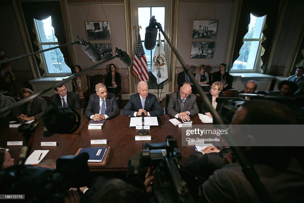 U.S. Vice President Joe Biden (C) makes brief remarks to the press at the beginning of a meeting with U.S. Attorney General <a gi-track='captionPersonalityLinkClicked' href=/galleries/search?phrase=Eric+Holder&family=editorial&specificpeople=1060367 ng-click='$event.stopPropagation()'>Eric Holder</a> (3rd L) and gun violence survivors and victims and gun safety advocacy groups in the Eisenhower Executive Office Building January 9, 2013 in Washington, DC. President Barack Obama appointed Biden to oversee a task force on gun violence.
