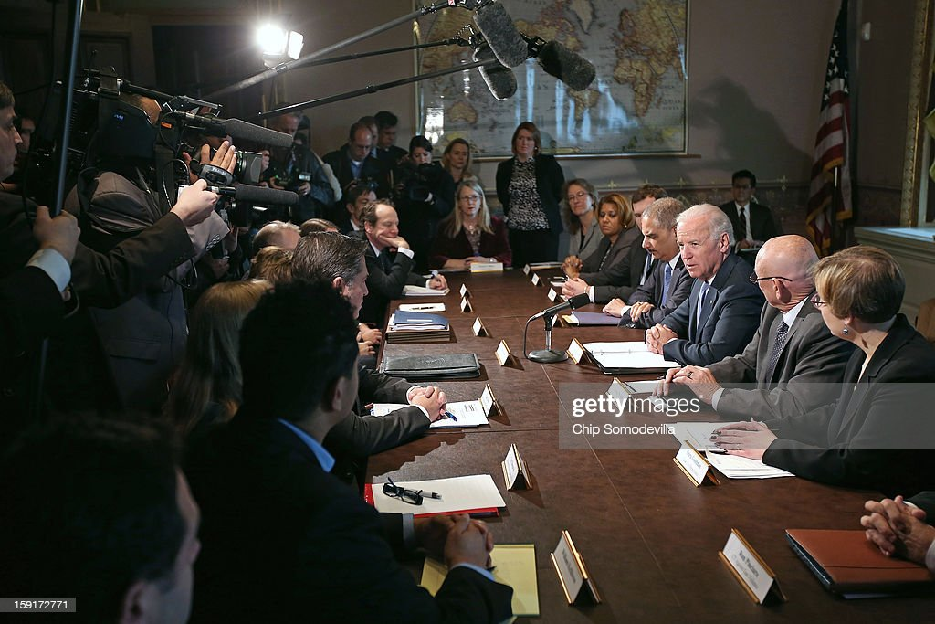 U.S. Vice President Joe Biden (3rd R) makes brief remarks to the press at the beginning of a meeting with U.S. Attorney General <a gi-track='captionPersonalityLinkClicked' href=/galleries/search?phrase=Eric+Holder&family=editorial&specificpeople=1060367 ng-click='$event.stopPropagation()'>Eric Holder</a> (4th R) and gun violence survivors and victims and gun safety advocacy groups in the Eisenhower Executive Office Building January 9, 2013 in Washington, DC. President Barack Obama appointed Biden to oversee a task force on gun violence.
