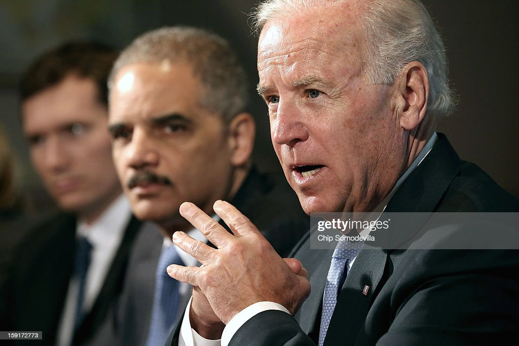 U.S. Vice President Joe Biden (R) makes brief remarks to the press at the beginning of a meeting with U.S. Attorney General <a gi-track='captionPersonalityLinkClicked' href=/galleries/search?phrase=Eric+Holder&family=editorial&specificpeople=1060367 ng-click='$event.stopPropagation()'>Eric Holder</a> (2nd R) and gun violence survivors and victims and gun safety advocacy groups in the Eisenhower Executive Office Building January 9, 2013 in Washington, DC. President Barack Obama appointed Biden to oversee a task force on gun violence.
