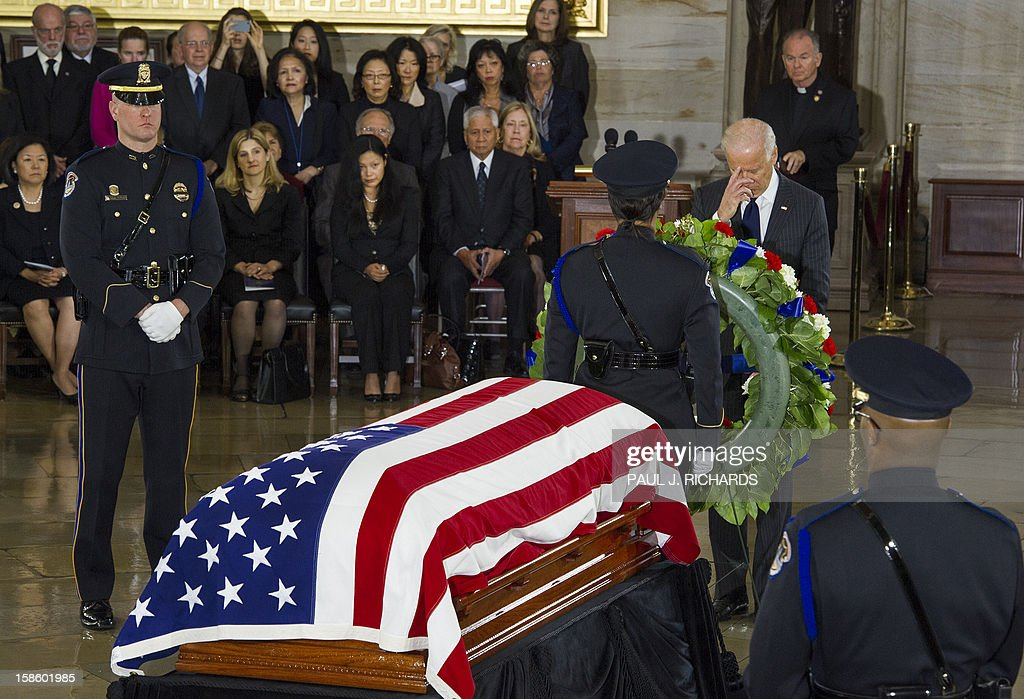 US Vice President Joe Biden, offers a prayer as US Senator Daniel K. Inouye,(D-HI) Lies In State in a flag covered casket on the floor of the US Capitol Rotunda December 20, 2012, in Washington, DC. Inouye, one of the last World War II heroes in Congress and the longest-serving member of the US Senate, having represented Hawaii since the state joined the union in 1959, died at age 88. AFP PHOTO/Paul J. Richards