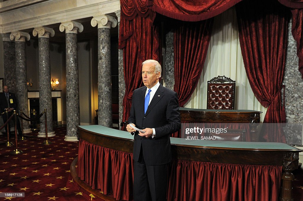 US Vice President Joe Biden participates in a reenacted swearing-in for US Senators in the Old Senate Chamber at the U.S. Capitol January 3, 2013 in Washington, DC. The 113th US Congress, featuring dozens of new faces in the House and Senate, convened Thursday fresh from the year-end 'fiscal cliff' fiasco, as lawmakers cast a wary eye towards the tough budget battles ahead. AFP PHOTO/Jewel Samad