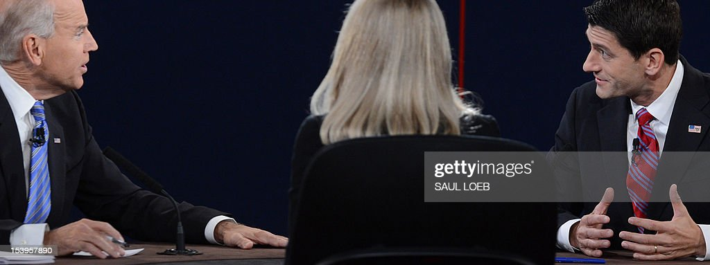 US Vice President Joe Biden (L) participates in the vice presidential debate with Republican vice presidential candidate Paul Ryan (R) at the Norton Center at Centre College in Danville, Kentucky, October 10, 2012, moderated by Martha Raddatz (C) of ABC News. AFP PHOTO / Saul LOEB