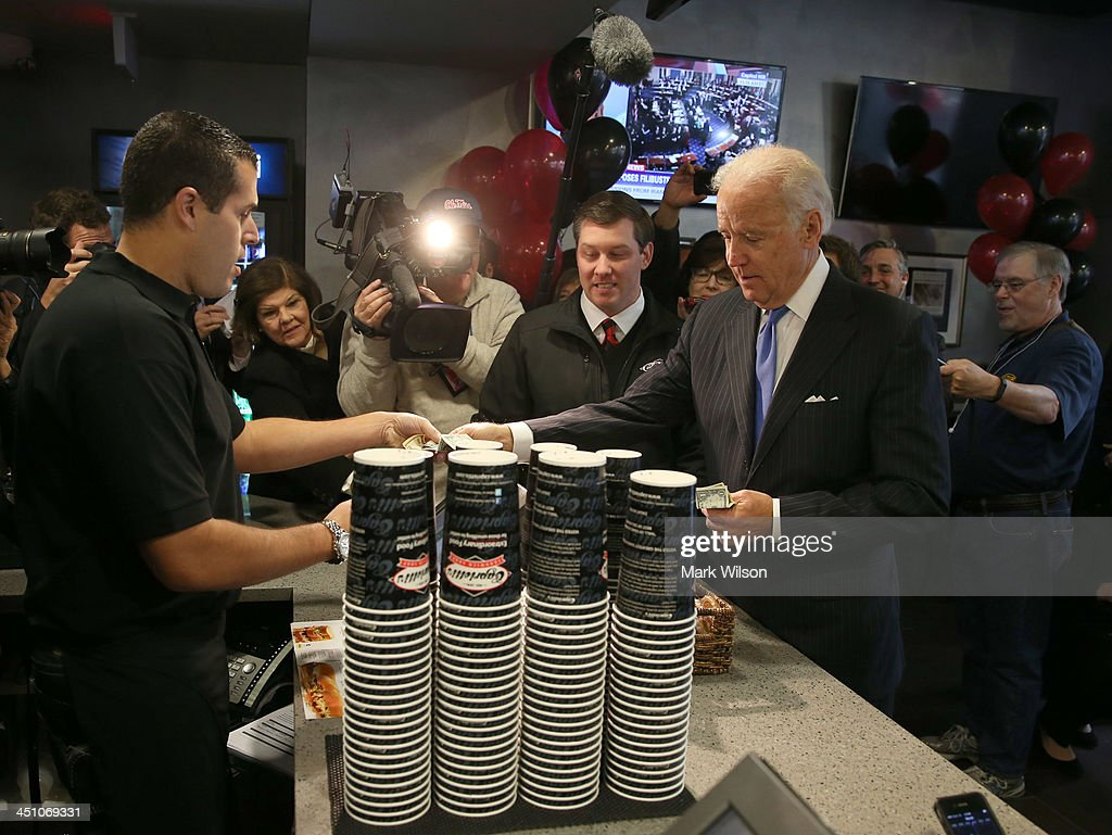 Vice President Joe Biden pays for his lunch at Capriotti's sandwhich shop, on November 21, 2013 in Washington, DC. Capriotti's is a Delaware based Italian hoagie chain and a favorite of the Vice President.