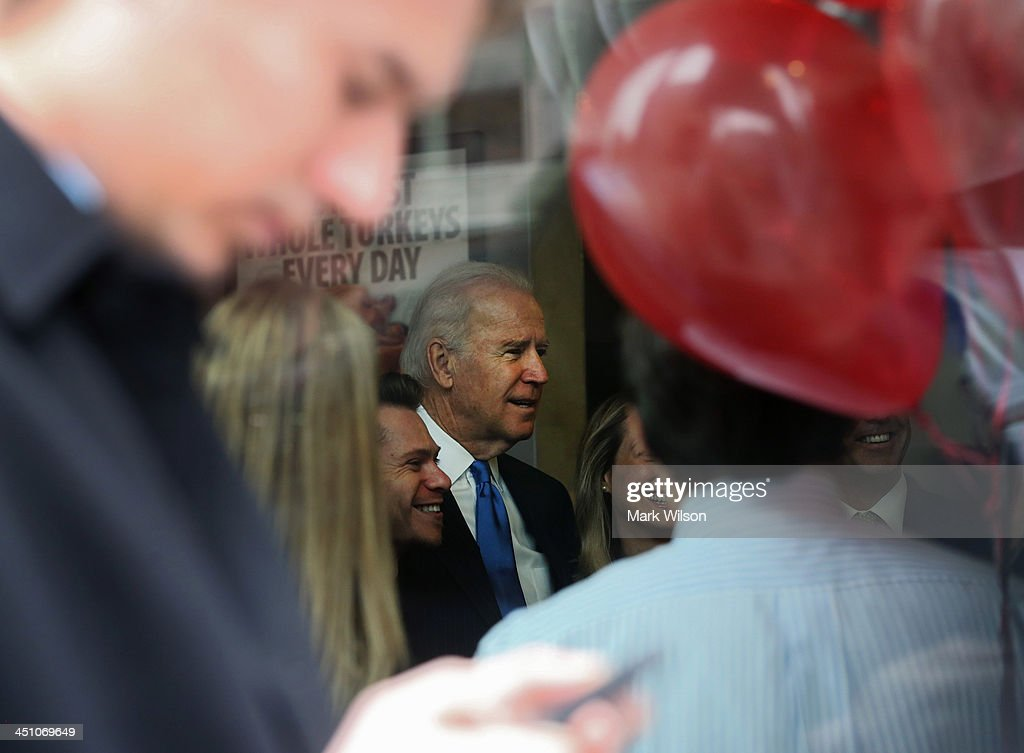 Vice President Joe Biden poses for pictures while picking up his lunch at Capriotti's sandwhich shop, on November 21, 2013 in Washington, DC. Capriotti's is a Delaware based Italian hoagie chain and a favorite of the Vice President.