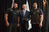 US Vice President Joe Biden poses with All Blacks rugby players Jerome Kaino and Charlie Faumuina during his visit to Auckland on July 21 2016 Biden...
