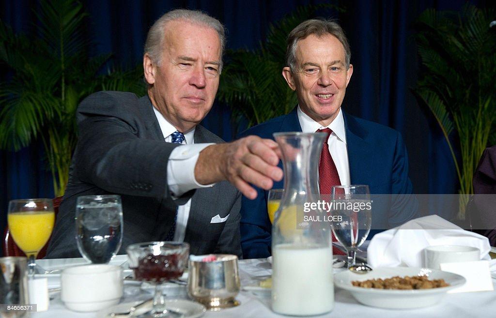 US Vice President Joe Biden reaches for the milk alongside former British Prime Minister Tony Blair during the National Prayer Breakfast at the Washington Hilton in Washington, DC, February 5, 2009. AFP PHOTO / Saul LOEB