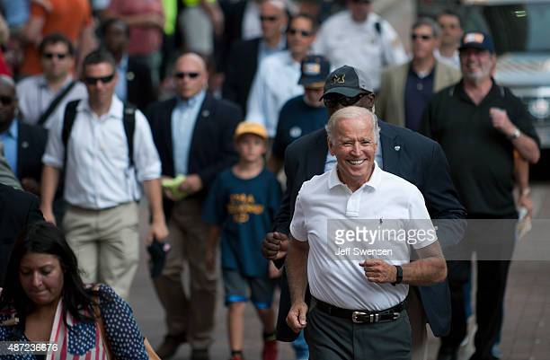 S Vice President Joe Biden runs while participating in the annual Allegheny County Labor Day Parade September 7 2015 in Pittsburgh Pennsylvania Biden...