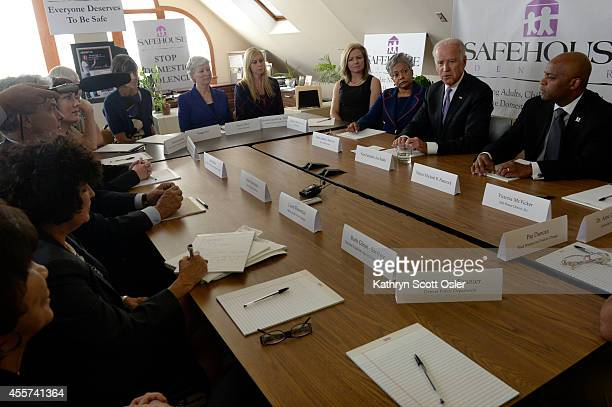 Vice President Joe Biden second from right travels to Denver to hold a roundtable discussion on domestic violence with Denver Mayor Michael Hancock...
