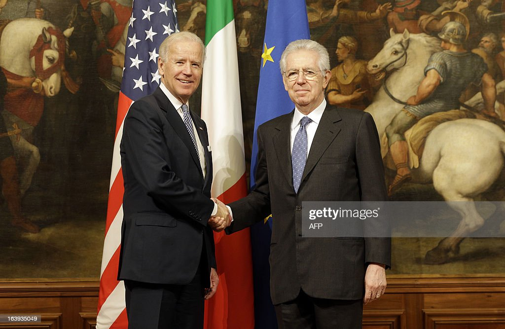 U.S. Vice President Joe Biden (L) shakes hands with Italian Premier Mario Monti at Palazzo Chigi in Rome on March 18, 2013. Biden is in Italy to attend the inaugural mass of newly-elected Pope Francis, which is to be held at the Vatican on Tuesday.