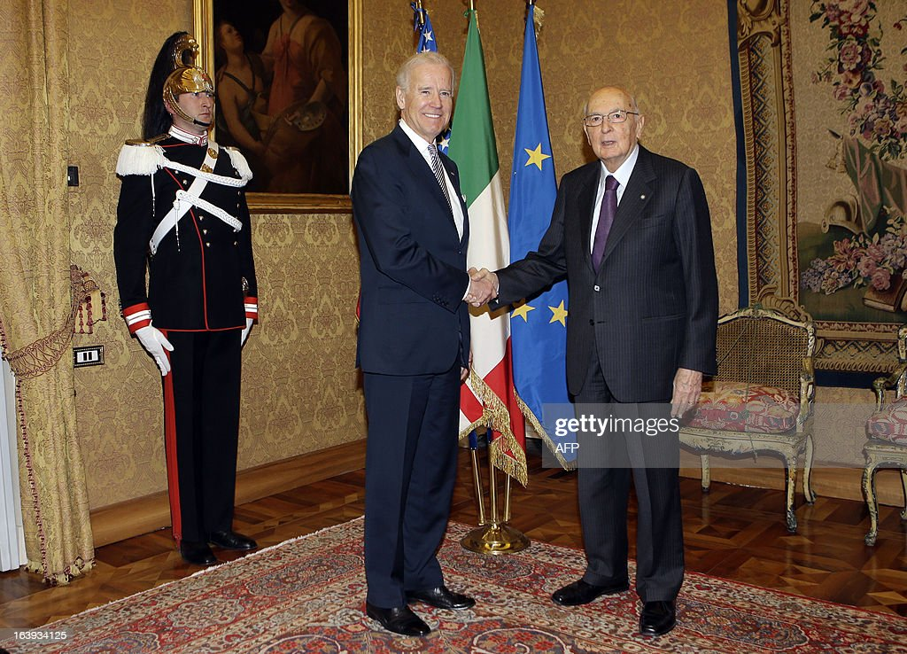 U.S. Vice President Joe Biden shakes hands with Italy's President Giorgio Napolitano (R) before their meeting at the Quirinale palace in Rome on March 18, 2013. Biden is in Italy to attend the inaugural mass of newly-elected Pope Francis, which is to be held at the Vatican on Tuesday. AFP PHOTO POOL / ALESSANDRA TARANTINO