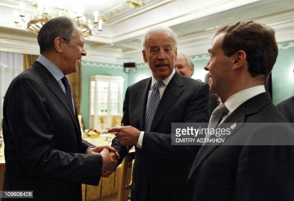 US Vice President Joe Biden shakes hands with Russian Foreign Minister Sergey Lavrov as he talks with Russian President Dmitry Medvedev on March 9...