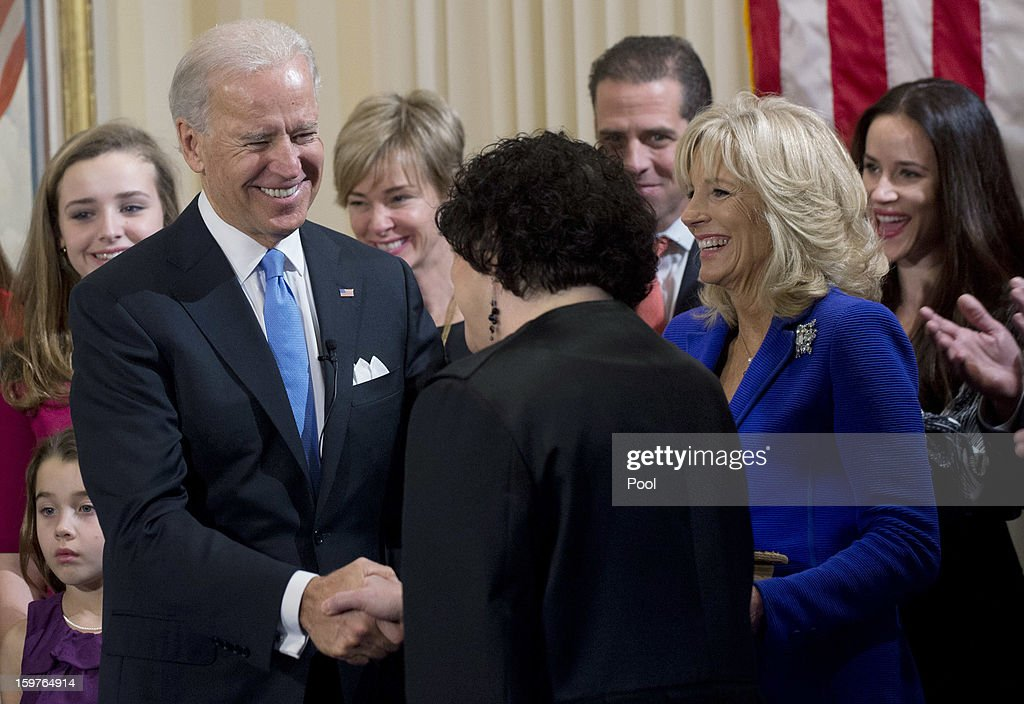 U.S. Vice President Joe Biden (L) shakes hands with U.S. Supreme Court Justice Sonia Sotomayor (3rd R) after taking the oath of office as his wife Dr. Jill Biden (2nd L) looks on during the official swearing-in ceremony at the Naval Observatory on January 20, 2013 in Washington, DC. Biden and U.S. President Barack Obama will be officially sworn in a day before the ceremonial inaugural swearing-in.