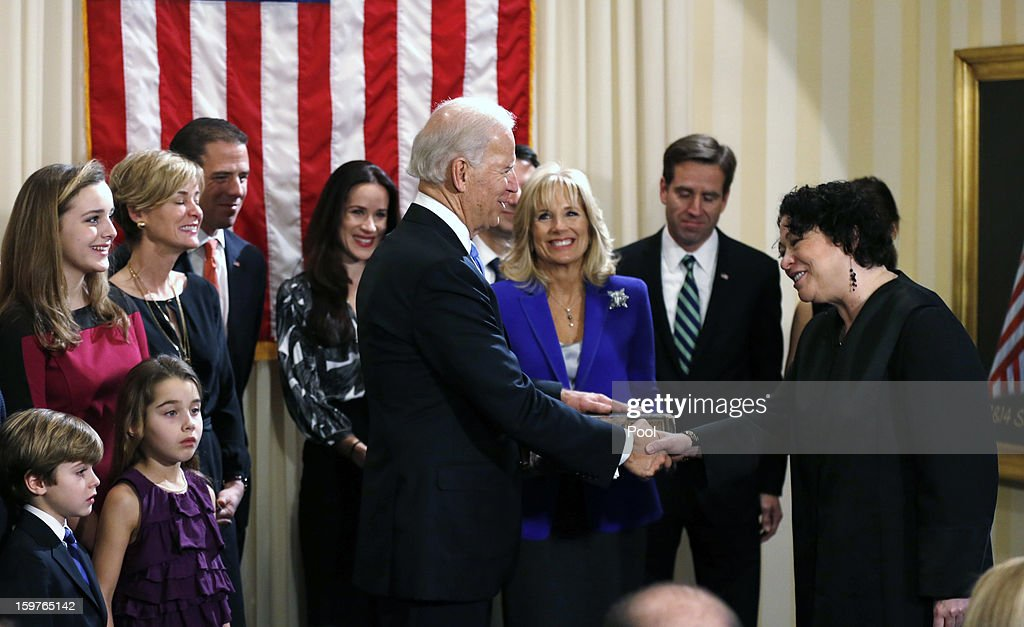 U.S. Vice President Joe Biden (4th R) shakes hands with U.S. Supreme Court Justice Sonia Sotomayor (R) after taking the oath of office as his wife Dr. Jill Biden (3rd R) looks on during the official swearing-in ceremony at the Naval Observatory on January 20, 2013 in Washington, DC. Biden and U.S. President Barack Obama will be officially sworn in a day before the ceremonial inaugural swearing-in.