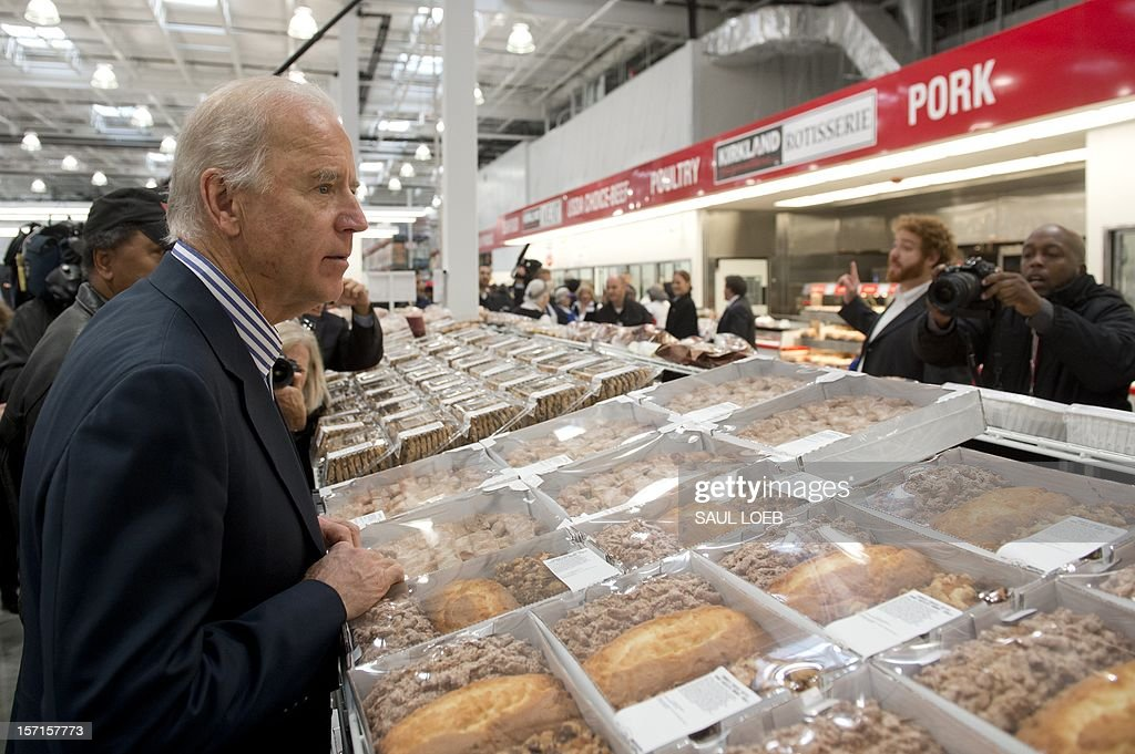 US Vice President Joe Biden shops for pies during a visit to a Costco store in Washington, DC, on November 29, 2012. Biden made the visit to the first Costco store located in Washington, DC, during its grand opening. AFP PHOTO / Saul LOEB