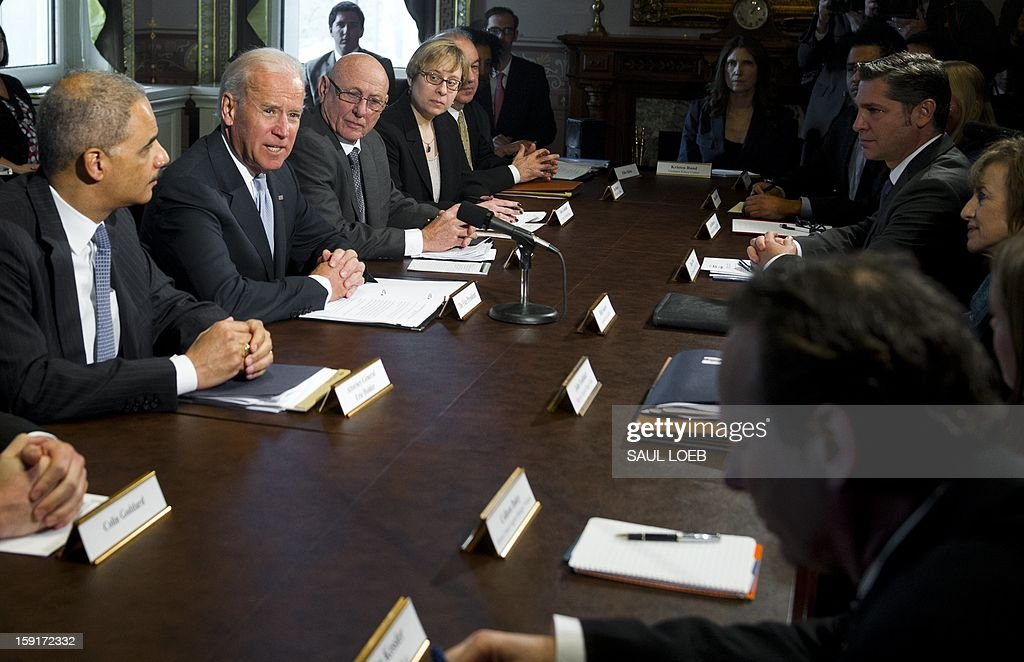 US Vice President Joe Biden (2nd L) speaks alongside Attorney General <a gi-track='captionPersonalityLinkClicked' href=/galleries/search?phrase=Eric+Holder&family=editorial&specificpeople=1060367 ng-click='$event.stopPropagation()'>Eric Holder</a> (L) as he meets with representatives of victims' groups and gun safety organizations at the Eisenhower Executive Office Building adjacent to the White House in Washington, DC, on January 9, 2013. The meeting comes as US President Barack Obama's administration works to develop gun policy proposals following last month's mass shooting in Newtown, Connecticut. AFP PHOTO / Saul LOEB