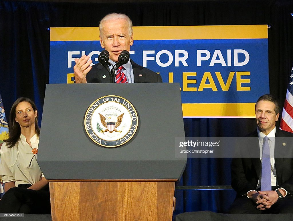 U.S. Vice President Joe Biden speaks as Christy Turlington (L) and NY Governor Andrew Cuomo (R) look on at a rally for paid family leave as he and NY Governor Andrew Cuomo deliver remarks on economy on January 29, 2016 in New York City.